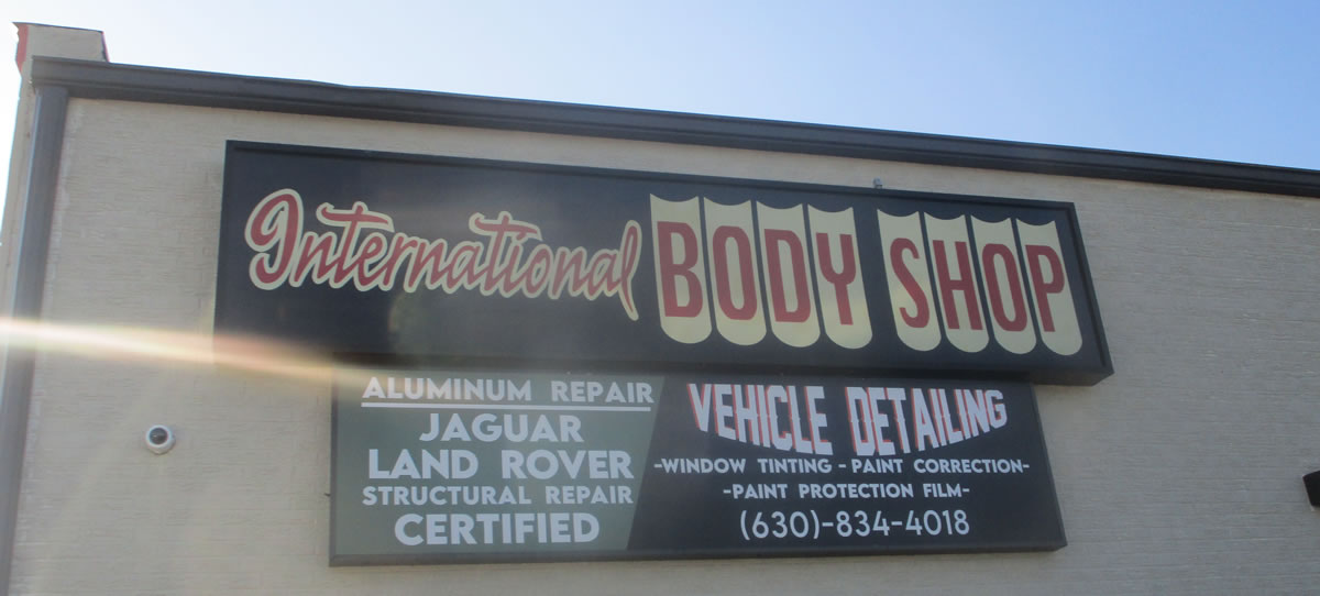 body-shop-sign-on-side-of-building